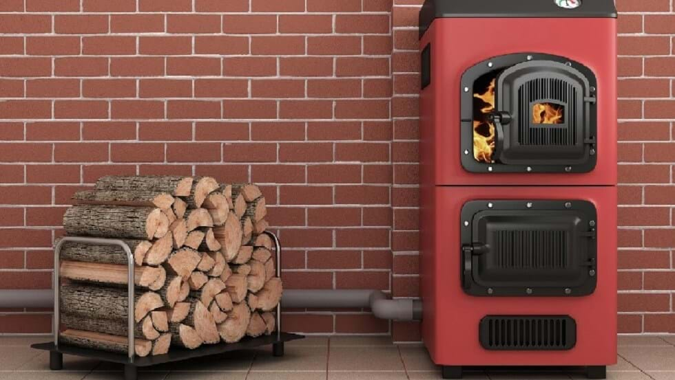 a biomass boiler with a wood stack near for fuel https://greener4life.com